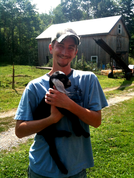 IT-Farmer Holding a Week Old Goat