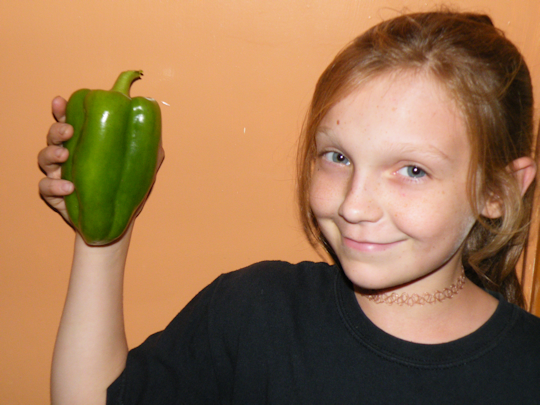 Jenny Holding a Large Pepper